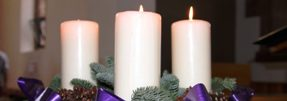 Advent wreath and three candles